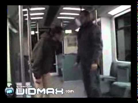 Aggressive man on subway gets Depantsed by German Giant